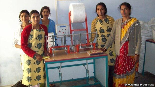 School girls making own pads