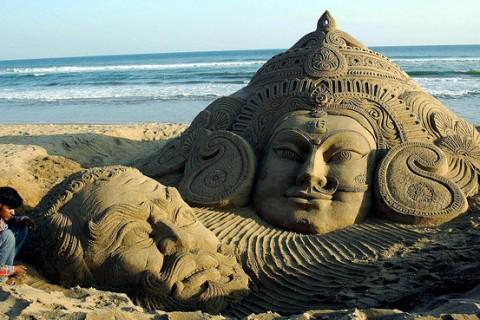 Durga and Mahishasur in sand